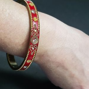 Gold tone and red bangle bracelet